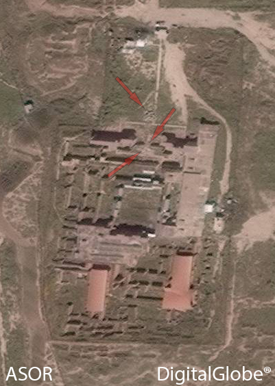 C) Nimrud, Northwest Palace, arrows point to rubble pile, cut in modern wall, and disturbance in Throne Room (DigitalGlobe; taken April 1, 2015)