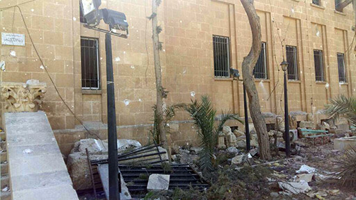 Figure 61. Exterior damage to museum following expulsion of ISIL (posted by DGAM; March 28, 2016).
