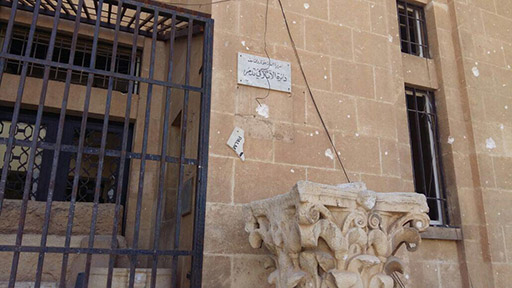 Figure 62. Exterior damage to museum following expulsion of ISIL (posted by DGAM; March 28, 2016).